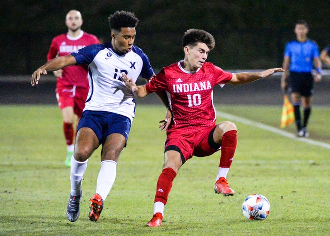 Indiana's Tommy Mihalic (10) fights for possession of the ball against Xavier's Jerome Jolly (13) during a match on Sept. 6, 2021, at Bill Armstrong Stadium.