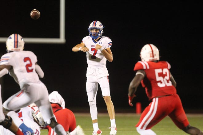 Hutchinson Blue Dragons quarterback Dylan Laible completes a pass to running back Tye Edwards against the Coffeyville Red Ravens Saturday, Sept. 4, 2021 in Coffeyville. The Red Ravens upset the Blue Dragons 17-10 and handed the defending national champions their first loss since 2019.