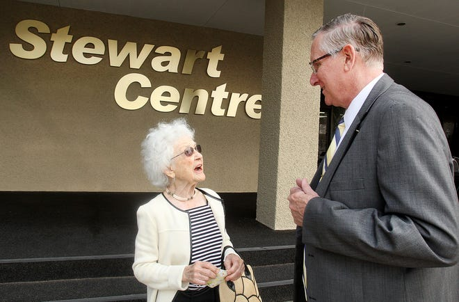 Brian Stewart, right, speaks with Marjorie Phillips, one of the original tenants of the State Bank building, now known as Stewart Centre, on Tuesday, Sept. 7, 2021, in downtown Freeport.