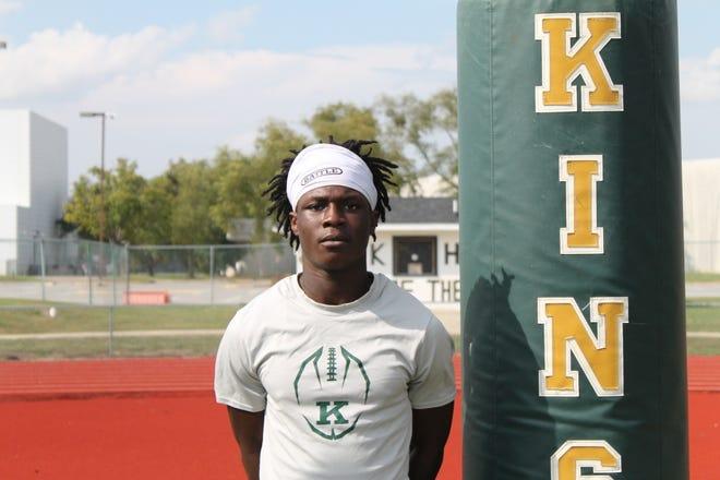 Kinston High's Calvin Holloway is balancing football and fatherhood as he wraps up his high school career.