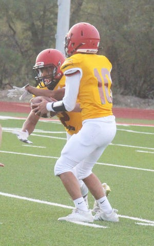 Rocky Ford High School quarterback Shaun Gonzales hands off to Luis Sarmiento in the Meloneers' game against Monte Vista on Aug. 27. The Meloneers visit Rye on Sept. 10, 2021.