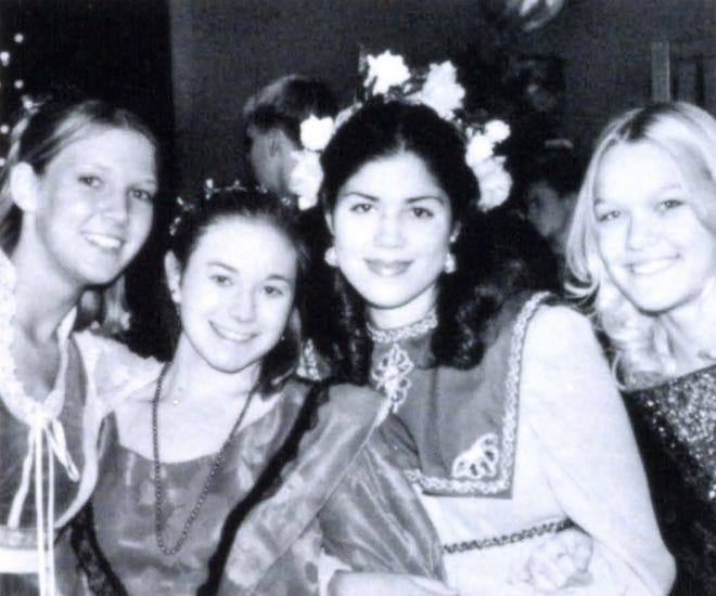 Pictures of the Past is from the 2001 Lincoln Community High School yearbook. The photo shows Heather Otto, Sara Farkas, Sarah, Carillo and Lindsey Spurling dressed up for the Madrigal show.