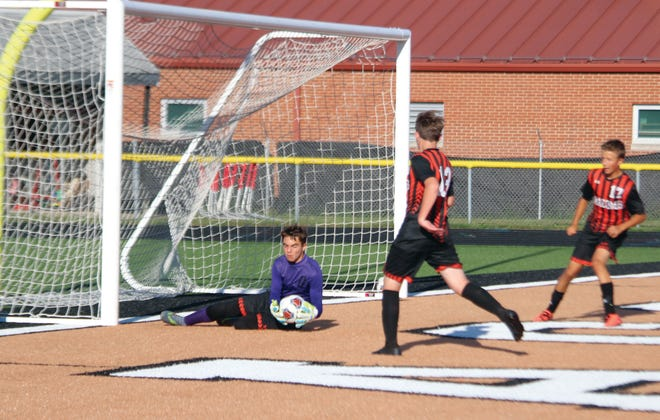 Macomb's Owen Benson makes a save during a game on Wednesday, September 8.