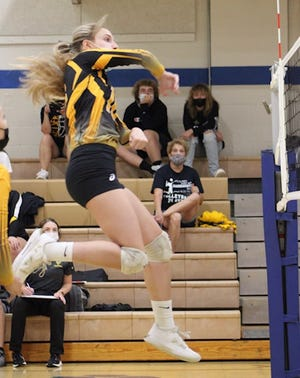 Keyser's Kaitlin Heavener jumps high and pounds the ball against Northern on Wednesday. Heavener had six aces, four kills, two blocks, three digs and nine points as the Lady Tornado defeated Northern three games to zero.