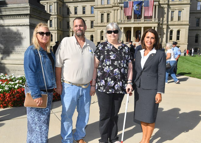 State Rep. Bronna Kahle (far right), R-Adrian, is joined by the family of fallen Blissfield Firefighter Joe Gallo for the annual Michigan House of Representatives 9/11 Memorial Ceremony. Capt. Gallo, 34, died in a car accident while responding to a barn fire in Deerfield Township in November, 2020.