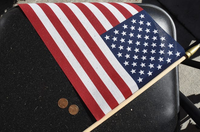A closeup of the American flags that rests on one of the 13 chairs at Lowe's in Frenchtown Township. The store has created a display to honor the 13 American servicemen who were killed by a suicide bomber on August 26.