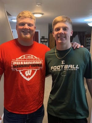 Mike (left) and his little brother Evan Furtney will play against each other when Eastern Michigan's football team visits Wisconsin today.