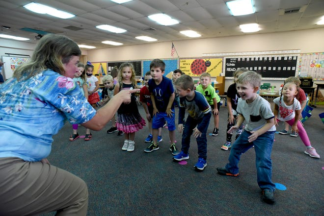 Anita Richards, an Army veteran who retired after 21 years of service, recently began her second career as a kindergarten teacher at Sodt Elementary School. She often leads her class through exercises designed to help them refocus.