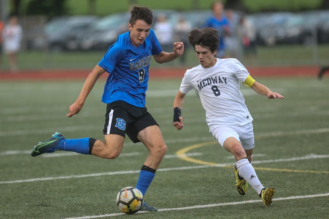 Dover-Sherborn's Harrison Smith takes a shot during the boys soccer game against Medway at Dover-Sherborn High School in Dover on Sept. 8, 2021.