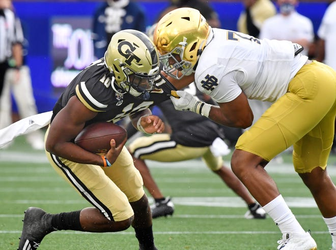 Isaiah Foskey, right, has a knack for chasing down quarterbacks, like Georgia Tech's Jeff Sims last season. But Notre Dame's starting vyper has added more linebacker duties to his defensive end role.