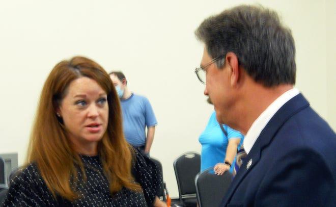 Oak Ridge Board of Education member Erin Webb talks to Oak Ridge Director of School Leadership Bruce Lay after a school board meeting.