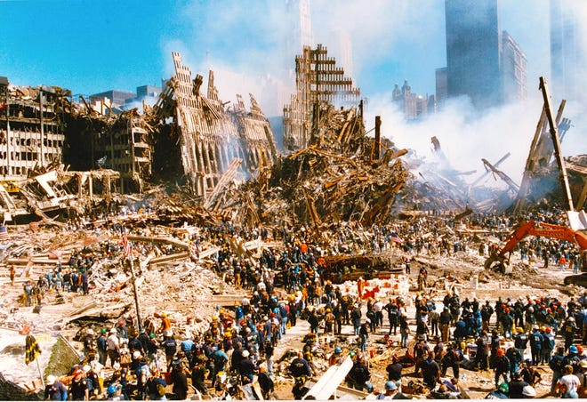 """""""That is our ladder truck,"""" Bill Sarro, a retired F.D.N.Y. firefighter said about the picture of the fire truck among the mangled steel of the Twin Towers on the week of Sept. 11, 2001. Sarro served at Ladder Company 105. He lost six of his friends from Ladder Company 105 that day in the twin towers. [Photo provided by Bill Sarro]"""