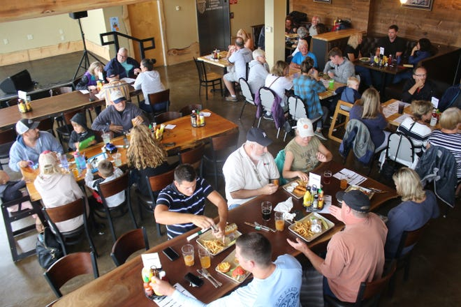 People enjoy eating lunch at Beards Brewery in Petoskey.