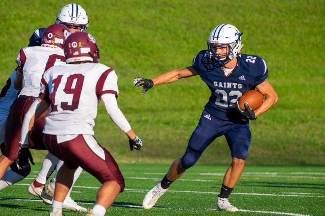 St. Thomas Aquinas junior Spencer Lassard looks for an opening during last Saturday's Division II football game against Timberlane. The Saints travel to Sanborn on Saturday for a 2 p.m. scheduled kickoff.