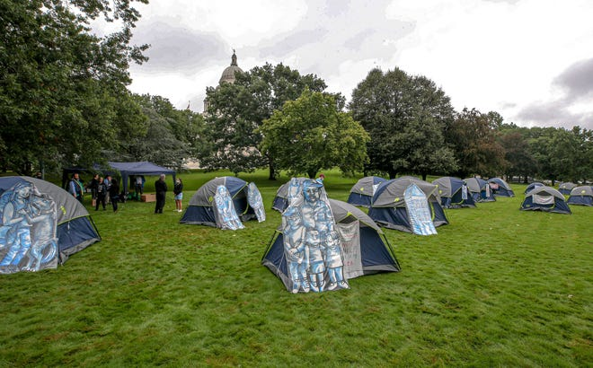 Advocates for Rhode Island's homeless population stage an encampment on the State House lawn Thursday.