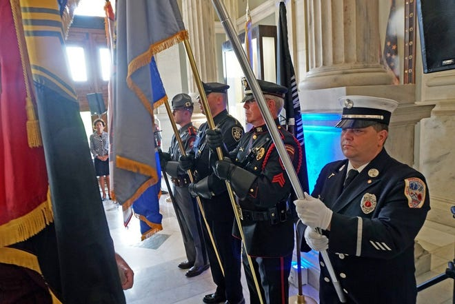 Then-Rhode Island Gov. Gina Raimondo stands by an honor guard during a 9/11 ceremony at the State House in 2019.