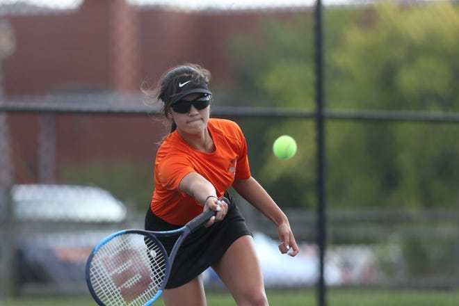West Warwick's Tianna-Lee Keovongvichit returns a shot from her opponent, Coventry's Kayleigh Reeves, in the girls No. 1 seed match.