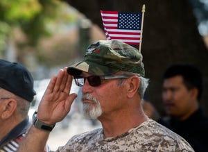Vietnam veteran Steve Spatola salutes during the VFW Luneta Post 52 9/11 observance at the Stockton Civic Memorial Auditorium in downtown Stockton.