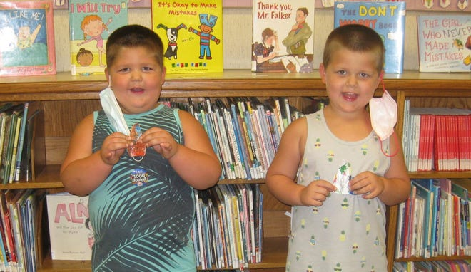 """Preschooler Apollo Drachenberg, left, and his brother, Atlas, right, who just started kindergarten, recently achieved their goal of hearing """"1,000 Books Before Kindergarten"""" in the Aurora Memorial Library's program that promotes early literacy."""