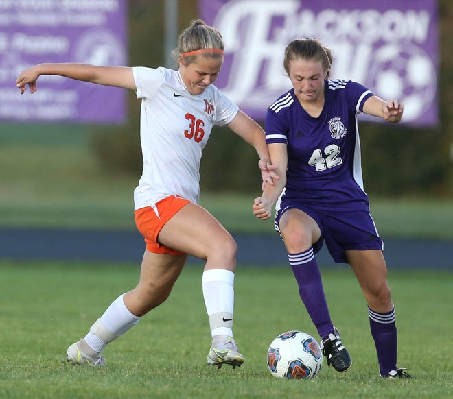 Laila Miller (6) of Hoover and Casey Stalder (42) of Jackson battle for the ball during their game at Jackson on Wednesday.