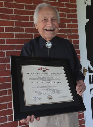 Ronald Van Dress, a World War II veteran, poses with his Bronze Star Medal certificate he received during the war. He will be interviewed about his service as part of the MAPS Air Museum's Military History Program, which works in conjunctionwith the Veterans History Project at the Library of Congress.