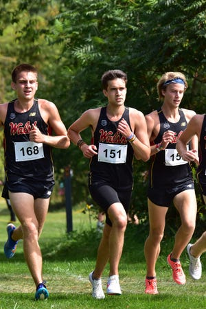 Nathan Moore (168), Drew Roberts (151) and Mitchel Dunham race for Walsh at the season-opening Tommy Evans Cross Country Invitational.
