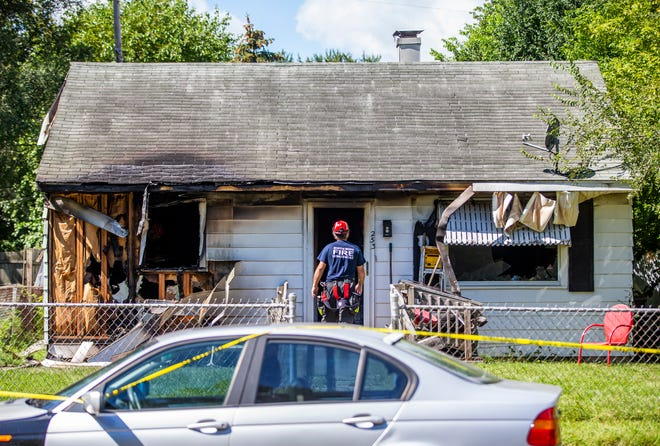 Fire crews at the scene of a house fire in the 200 block of N. Kenmore Street on Thursday, Sept. 9, 2021, in South Bend.