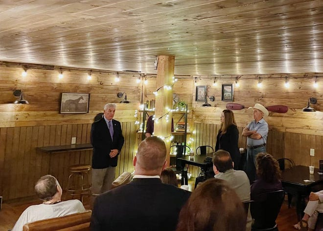 Rep. Roger Williams, R-Texas 25, visits with local constituents and business owners during a meeting on Thursday morning in Stephenville hosted by the Stephenville Chamber of Commerce.