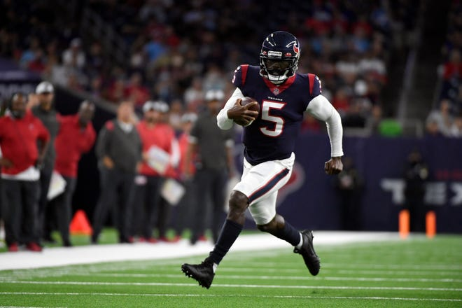 Houston Texans quarterback Tyrod Taylor (5) runs for a first down against the Tampa Bay Buccaneers during the first half of a preseason game on Aug. 28, in Houston.