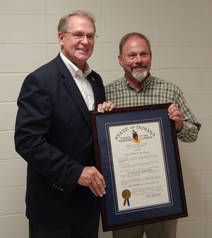 Rep. Bob Heaton presented Dave Allen with the Sagamore of the Wabash award recently at Owen Valley High School.