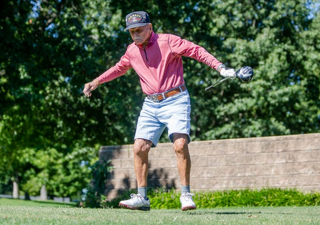 Guy Ellis, of Decatur, Ill., an 100-year-old WWII Veteran with the U.S. Navy, jumps and spins as he celebrates his drive that went right down the middle on the No. 6 hole during the Springfield Vs. Decatur Veteran's Challenge at Bunn Golf Course in Springfield, Ill., Thursday, September 9, 2021. [Justin L. Fowler/The State Journal-Register]