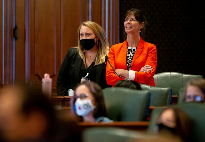 State Rep. Kelly Burke, D-Evergreen Park, watches the vote board as representatives vote Thursday to accept Gov. JB Pritzker's amendatory veto on Senate Bill 539, an omnibus ethics package, on the floor of the Illinois House of Representatives at the state Capitol. [Justin L. Fowler/The State Journal-Register]