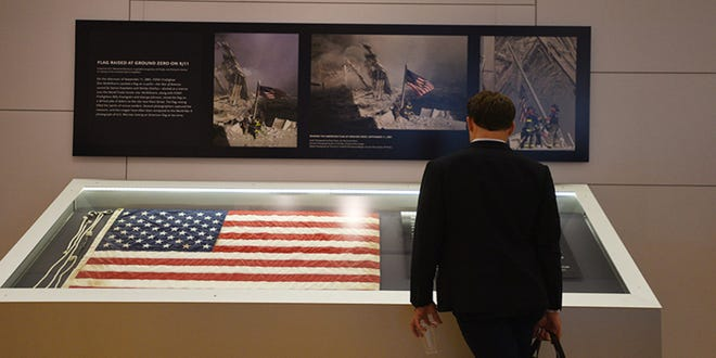 A visitor views a flag that flew at Ground Zero following the Sept. 11, 2001 attacks on the World Trade Center in New York City.
