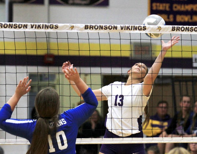 Macy Covey of Bronson sends a ball back over the net against Springport in prep volleyball action on Wednesday.