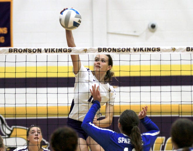 Bronson's Aubree Calloway hammers home a kill against Springport in prep volleyball action on Wednesday.