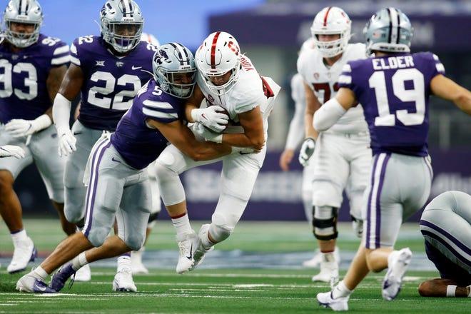 Kansas State linebacker Ryan Henington (5) tackles Stanford tight end Benjamin Yurosek (84)  during last Saturday's game at AT&T Stadium in Arlington, Texas.