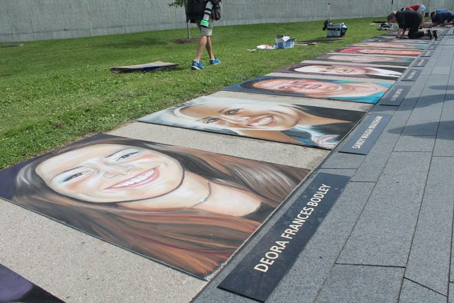 Chalk portraits of the 40 passengers and crew of United Airlines Flight 93 are shown Thursday at the national memorial near Shanksville.