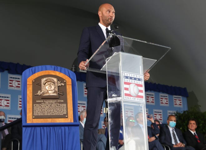 Derek Jeter speaks to the crowd during his induction ceremony Wednesday at the Baseball Hall of Fame in Cooperstown, New York.