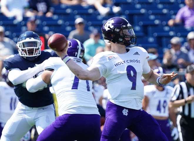 Holy Cross quarterback Matthew Sluka unleashes a pass during the first quarter against Connecticut last Saturday.