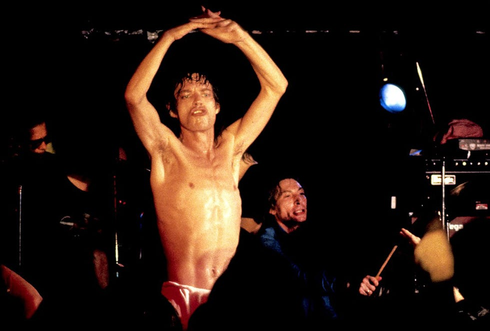 A sweaty and bare-chested Mick Jagger performs as Charlie Watts pounds the skins on Sept. 14, 1981 at Sir Morgan's Cove.