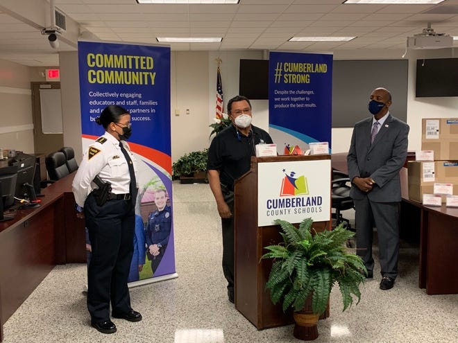 Cumberland County Schools Safety and Security Director Bruce Morrison - alongside Fayetteville Police Chief Gina Hawkins and Cumberland County Schools Superintendent Dr. Marvin Connelly Jr. - explains how to use the new Nightlock door barricades.