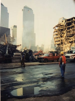 Smoke was still rising from the ruins in New York days after the 9/11 attacks, when the first group from Etowah County arrived to offer whatever assistance they could.