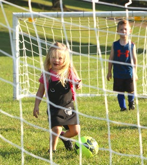 Hazel Monty prepares to take a shot on goal at the Orbit Soccer Fields at Otis Park Tuesday evening. Monty was only practicing, she plays on Saturdays in the Orbit Tots League.