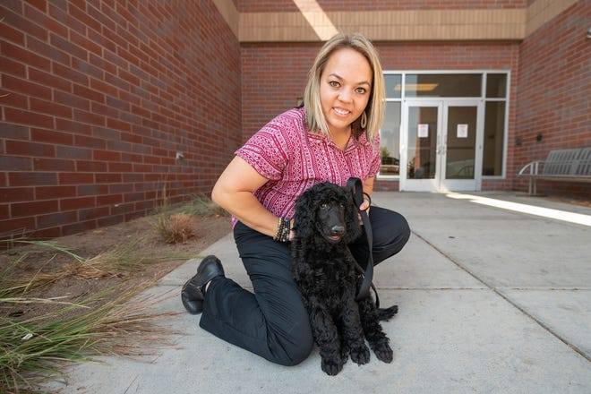 Pueblo Police Officer Meagan Chapman hangs out with the department's new comfort dog Ami on Thursday, September 9, 2021