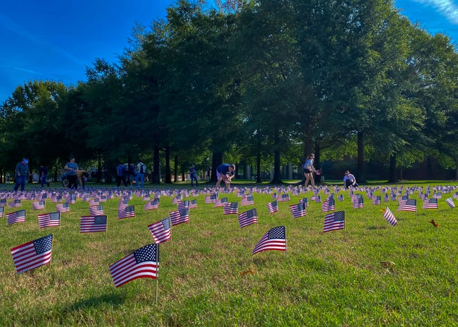 University of Arkansas at Fort Smith students, faculty and staff planted 3,000 flags on the campus green in preparation for the 9/11 memorial to be held Friday, Sept. 10.