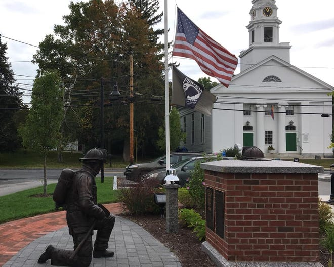 Flags fly at half staff at the Littleton firefighters memorial on Sept. 11, 2019, in honor of the victims of 9/11.