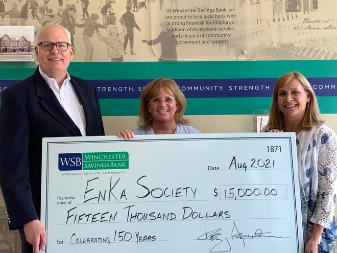 Pictured, from left: Peter J. Segerstrom, president and CEO, Winchester Savings Bank; Kate Carpini, president, En Ka Society; and Deborah A. Carson, chair of the board of trustees, Winchester Savings Bank.