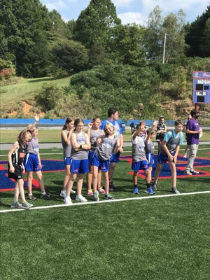 Cross-country runners from Rosman, Mountain Heritage, Avery County, Mitchell and Madison wait at the starting line of the girls and boys middle school two-mile run during Sept. 7's Patriot Invitational at Madison High School.
