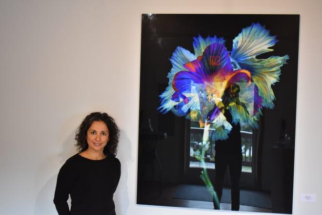 Pictured is Miryam Rojas, Mars Landing Galleries owner.