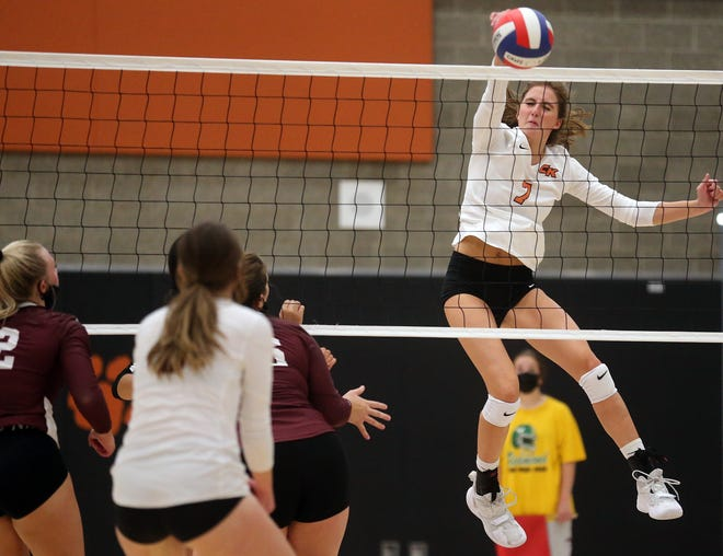 Central Kitsap's Camryn Lingenbrink (7) leaps into the air and spikes the ball over the net against South Kitsap in Silverdale on Wednesday, Sept. 8, 2021.